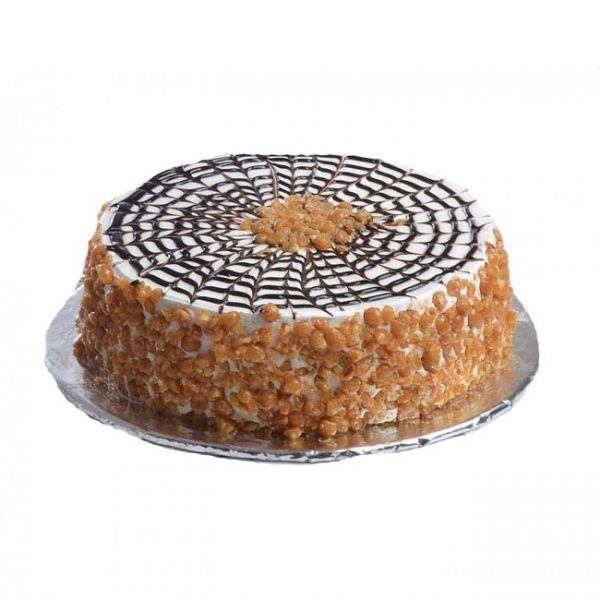 Round shaped butter scotch cake decorated with butter scotch on side and top