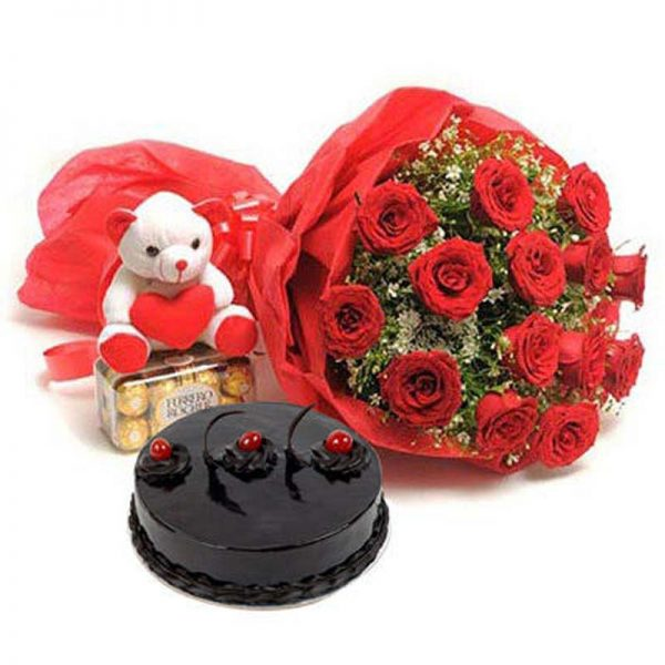 15 Red Roses wrapped in red paper & tied with ribbon with a 6 in teddy, 1kg chocolate truffle cake and chocolate box
