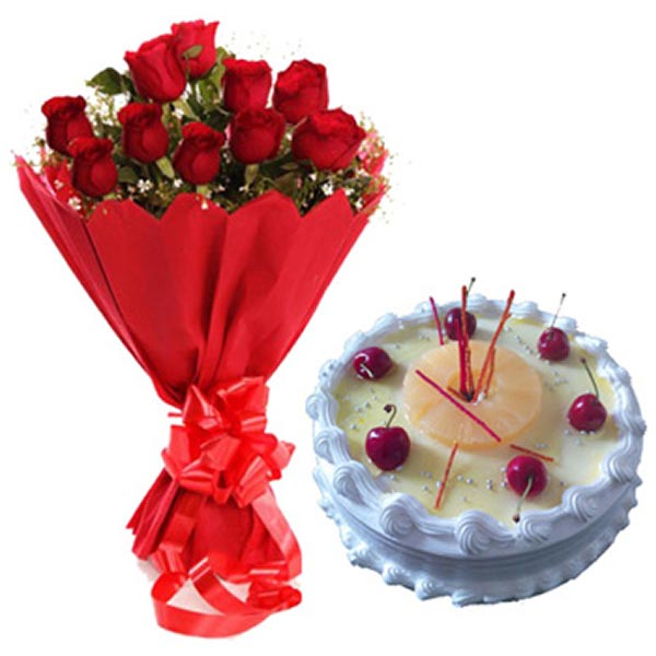 Red roses wrapped with red paper, and round shaped cake