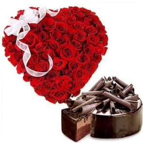 Heart shaped bouquet of red roses, round shaped chocolate cake