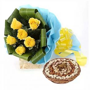 6 yellow roses with green leaves wrapped in blue paper and tied with yellow ribbon and 1 Kg dryfruit basket