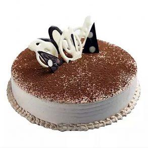 round shape tiramisu cake decorated with chocolate powder