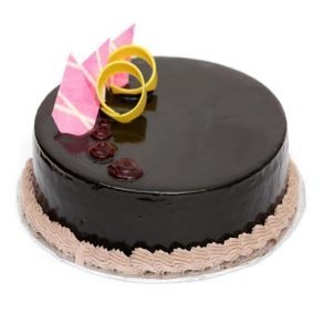 Round shaped chocolate cake with pink chocolate on top