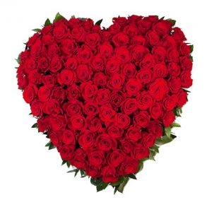 Heart shaped flower arrangement of red roses