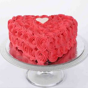 Heart shaped chocolate cake decorated with red roses design on top