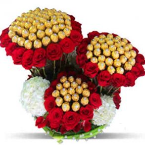 Red roses, white carnations and ferrero rocher chocolate bouquet