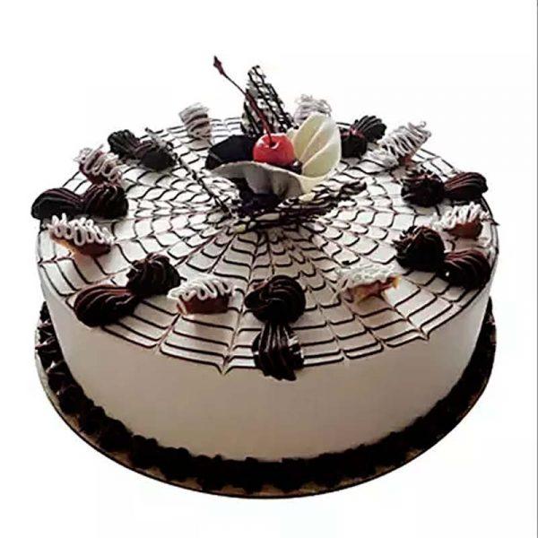 round shaped vanilla cake decorated with chocolate and white & chocolate cream on top