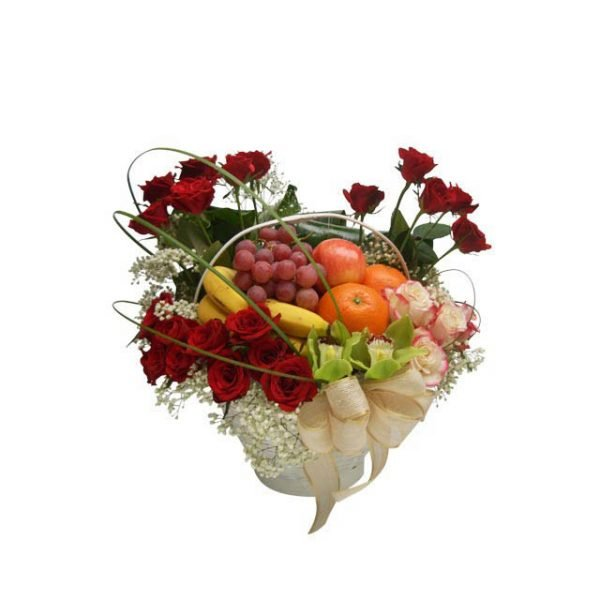 Fruit basket decorated with red roses and green leaves