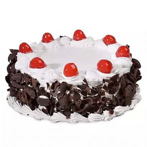 Round shaped black forest cake decorated with chocolate on side and white cream with red cherries on top